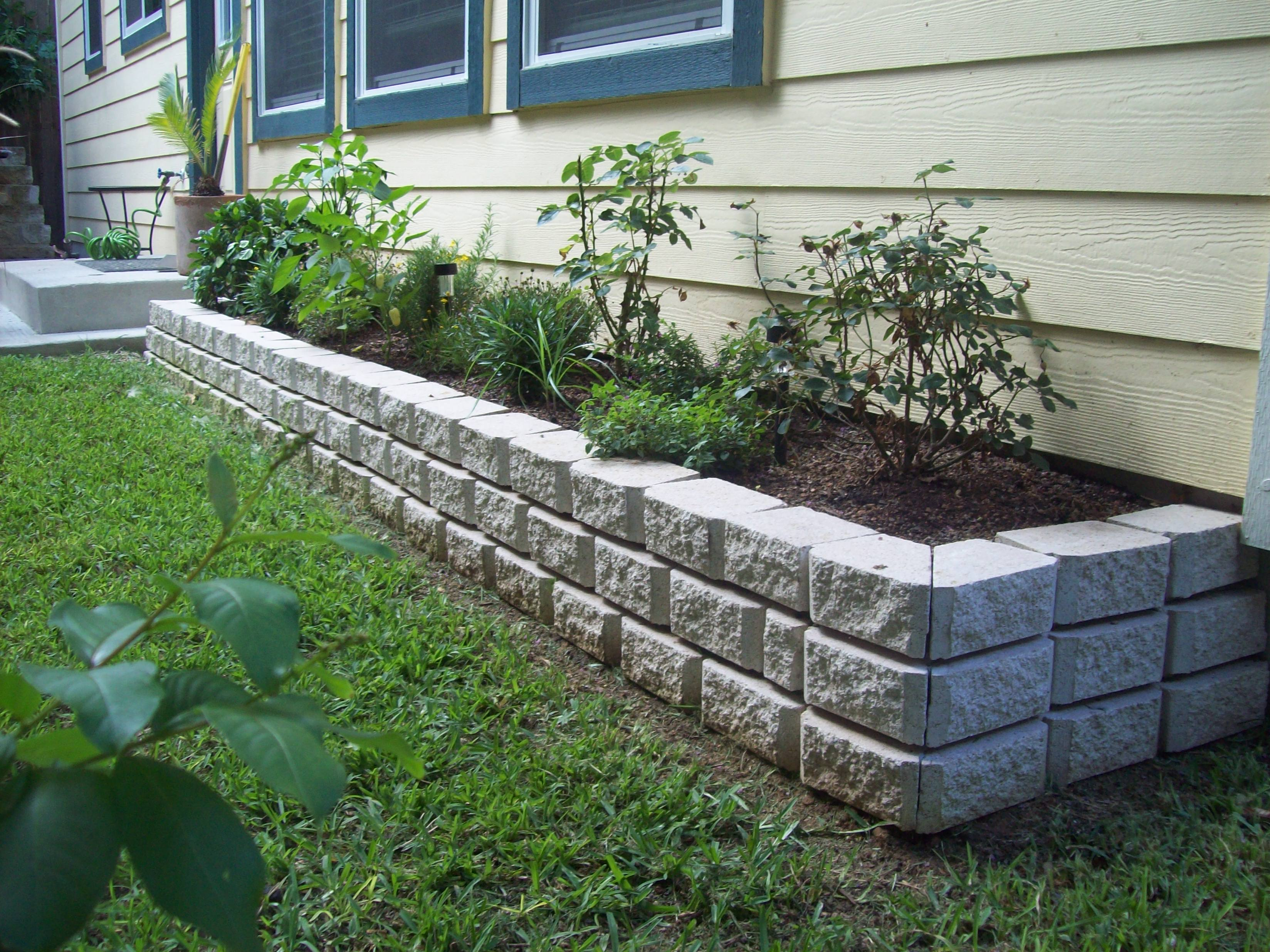 Stone Flower Bed : of three layers of white stone, and filled with rich soil, this bed ...